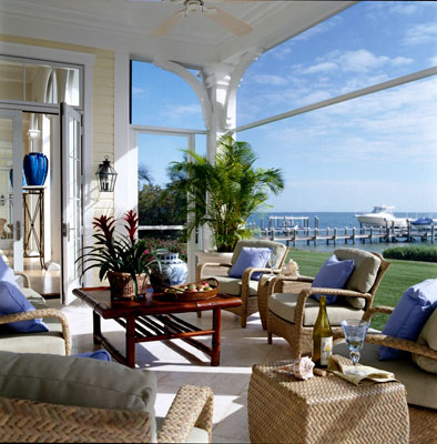 A sunlit screened in porch on the water