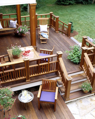 A stained deck with adirondack chairs