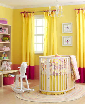 A yellow nursery with red accent colors