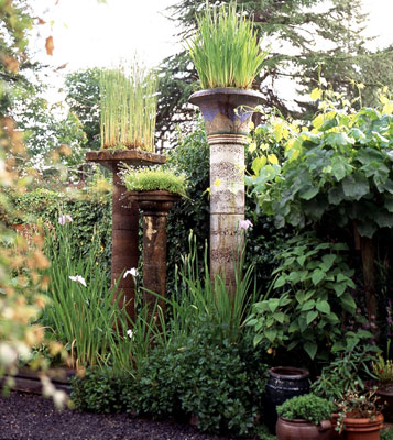Mutli-height pillars with plants growing on top of each one