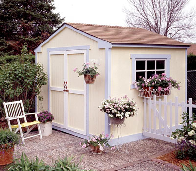 Exterior view of a shed surrounded by plants