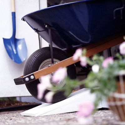 Wheelbarrow rolling down a ramp
