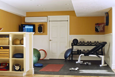 A small weight room with a weight set