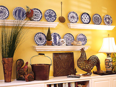 Shelves with crown-molding on them holing up several styles of plates