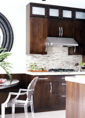 A kitchen with modern dark wood cabinets