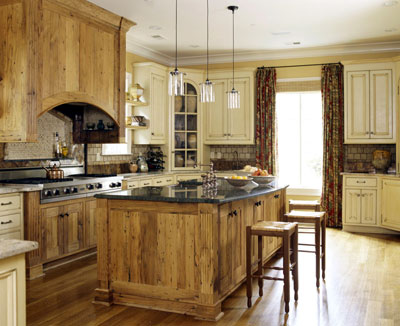A rustic kitchen with wood style cabinets and wood floors