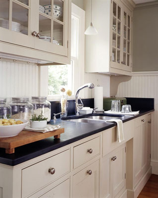 A kitchen with stock white cabinets