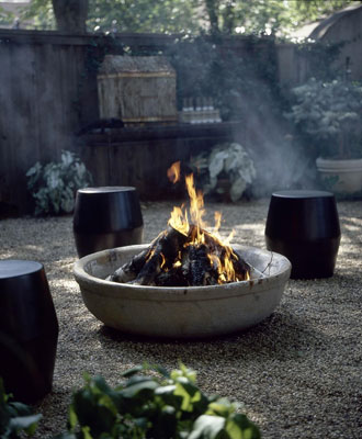 A firepit with small barrells around it