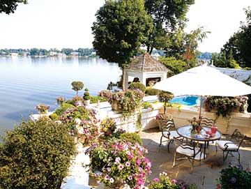 Patio on the water surrounded by plants