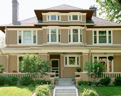 Victorian style house with tan exterior paint color