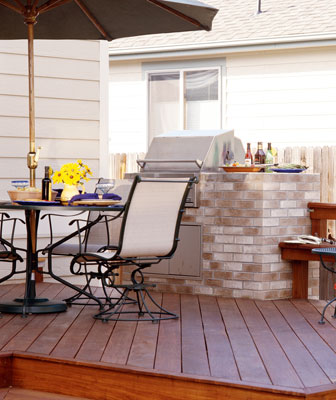 A deck with a built-in grill