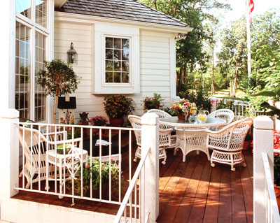 Attached deck with wicker dining set