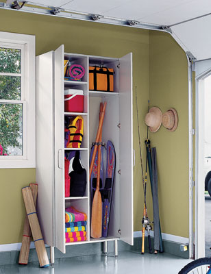 A full-height cabinet storing water and camping equipment