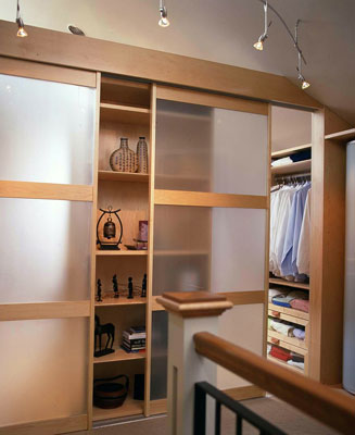 A closet hidden behind translucent sliding doors