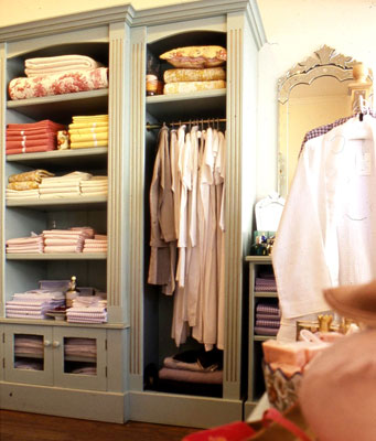 A closet with custom moldings for all of the shelving