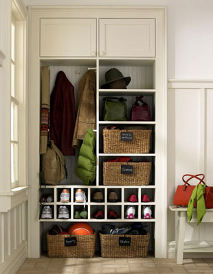 A closet built into a mud room to hold everyone's things