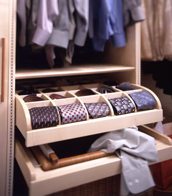A small roll-out cubby for ties