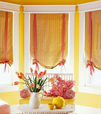 Windows with fabric roll-up curtains