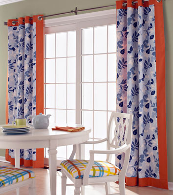 Orange and blue curtains over a slider